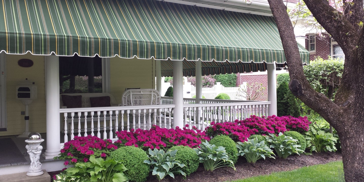 Beautiful striped Sunbrella porch awning. Lititz PA