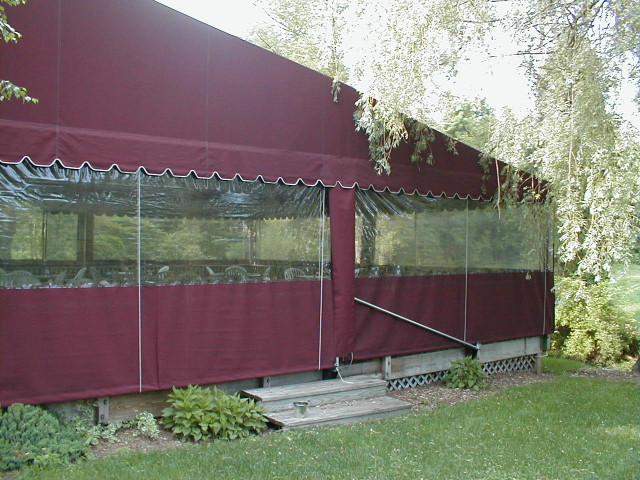 Stationary deck canopy with clear side wall enclosure