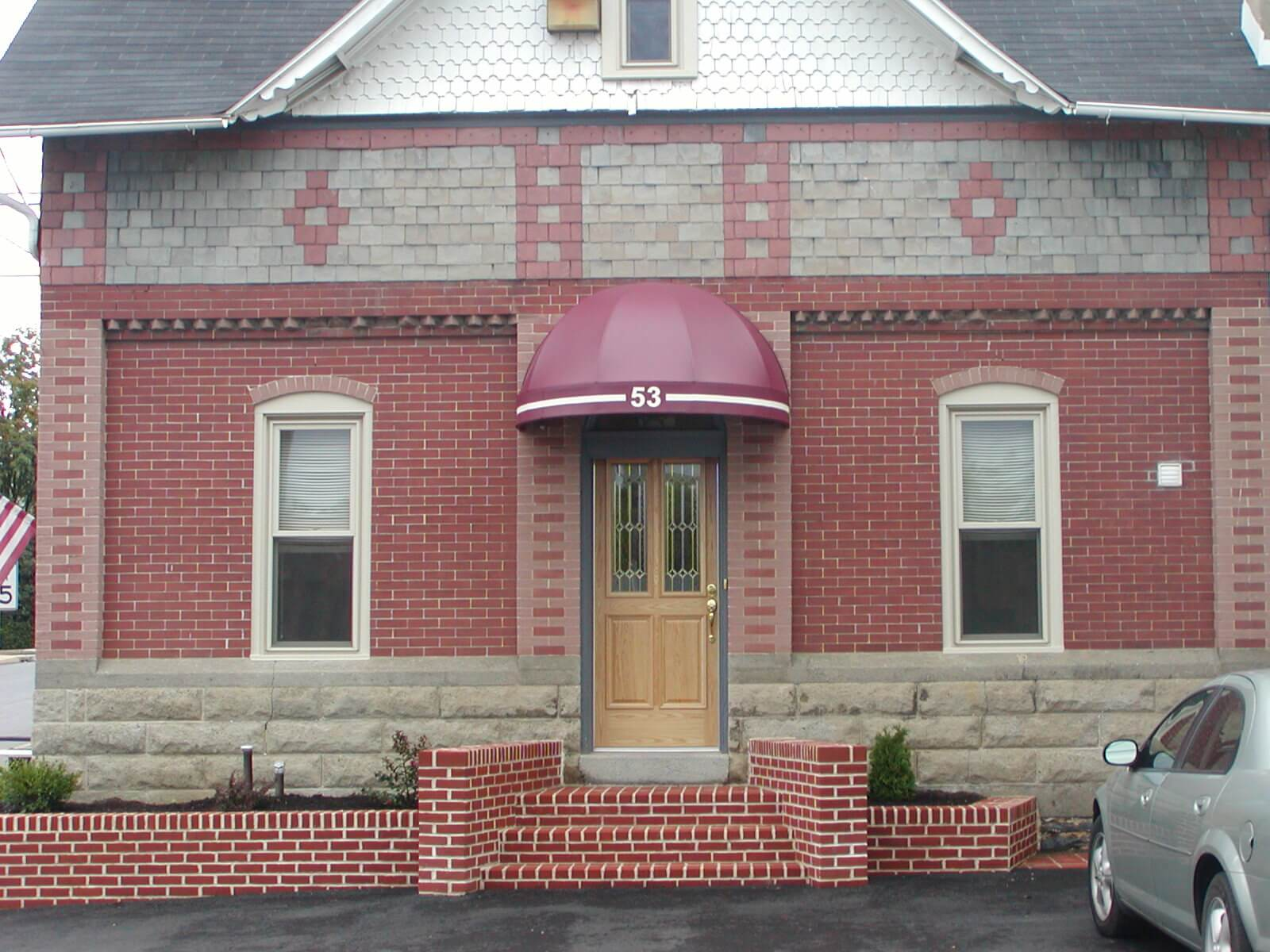 Bullnose Door Awning On A Brick Building Kreider S