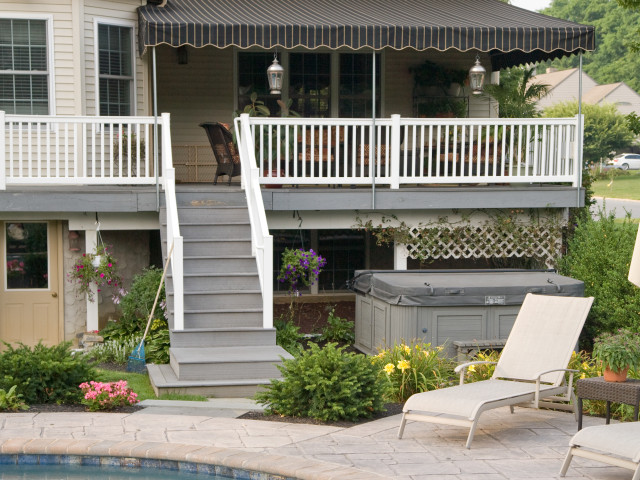 Wall mounted Sunbrella deck awning - cooper black stripe