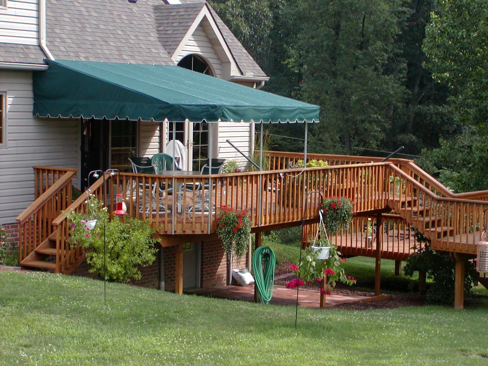 cover patio above awning decks with for portfolio interlaced custom fabric awnings all stationary covers items