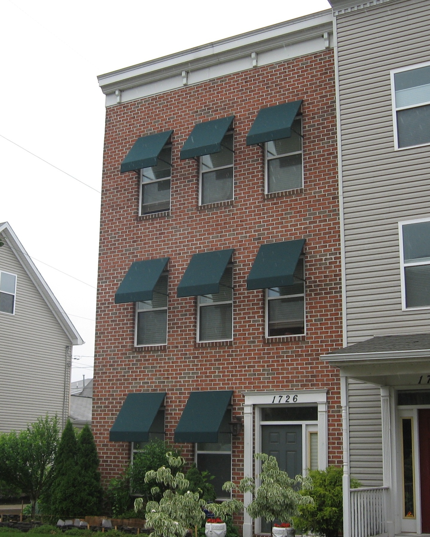 Welded Frame Window Awnings On A Brick Home Kreider S
