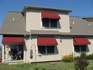 resdidential shed style porch and window awnings