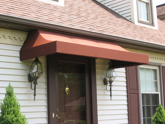 Sunbrella awning installed over a door