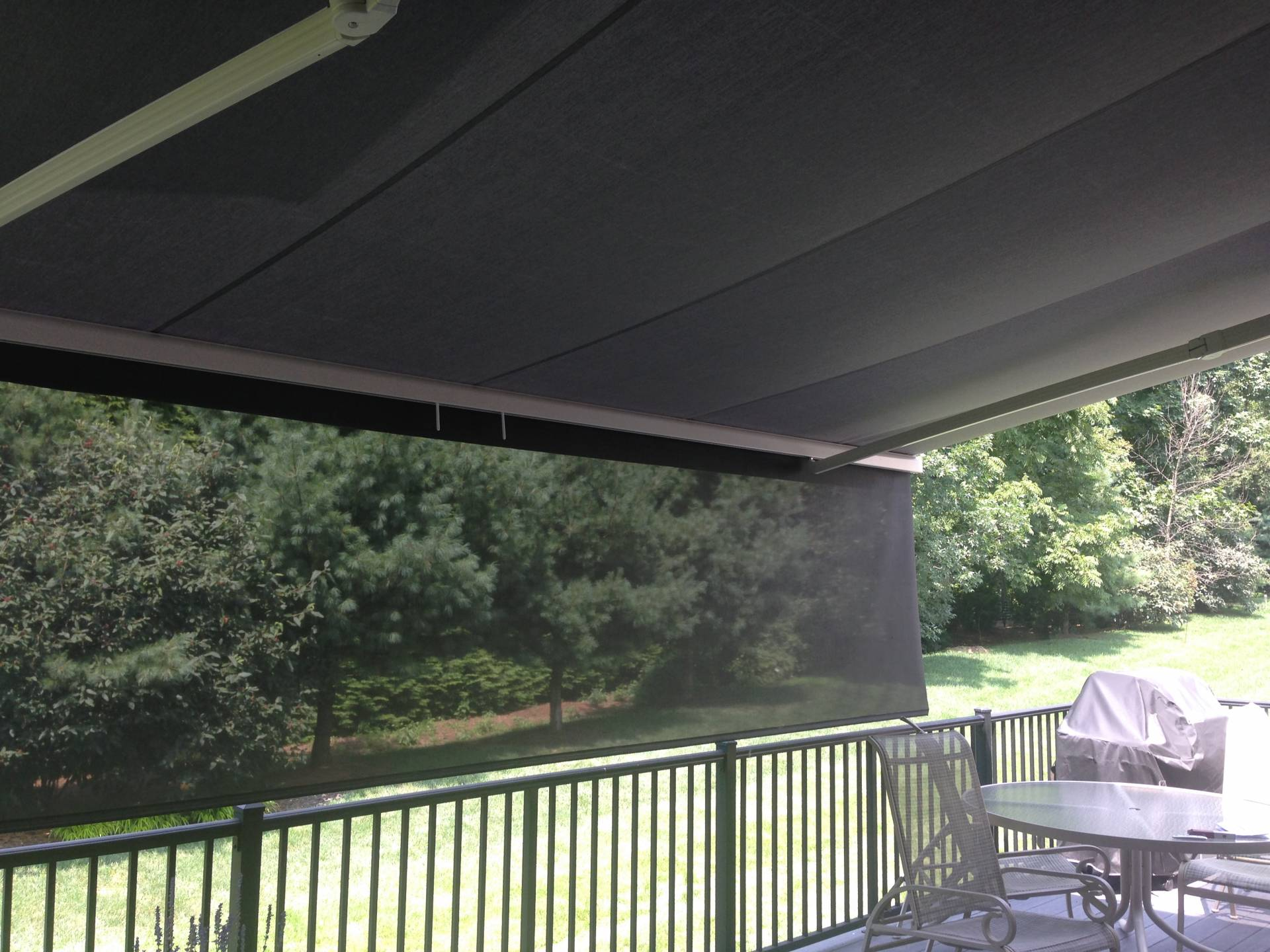 Wall mounted awning kreider 39 s canvas service inc for Retractable walls commercial
