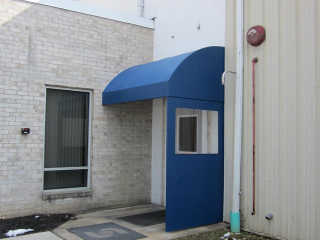 Clear Side Panel On A Blue Commercial Awning Kreider S