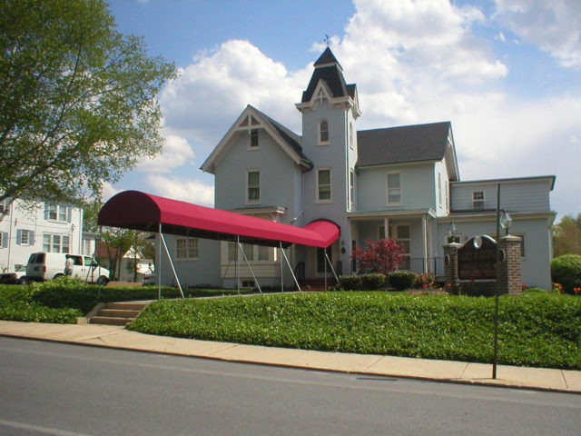 Burgundy Sunbrella fabric commercial awning