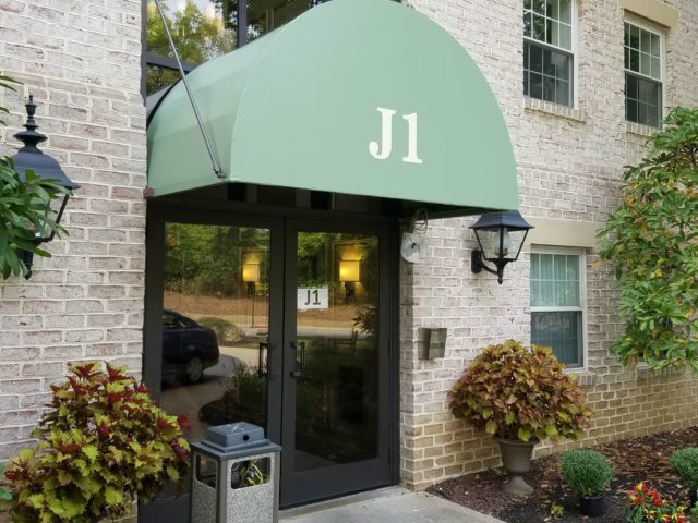 door awning with lettering sign