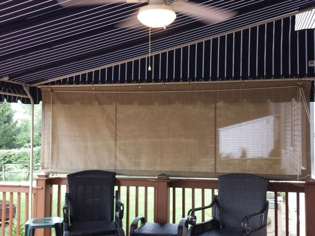 Mesh drop curtain on a canopy