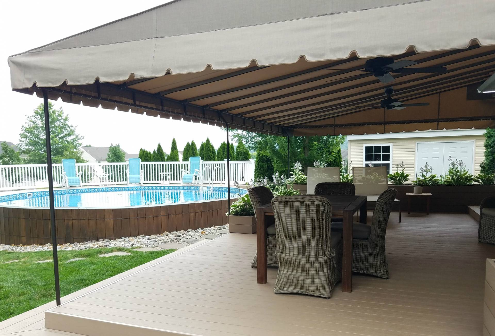 stripe sunbrella awnings stationary living for outdoor wall cooper decks pin black deck awning mounted