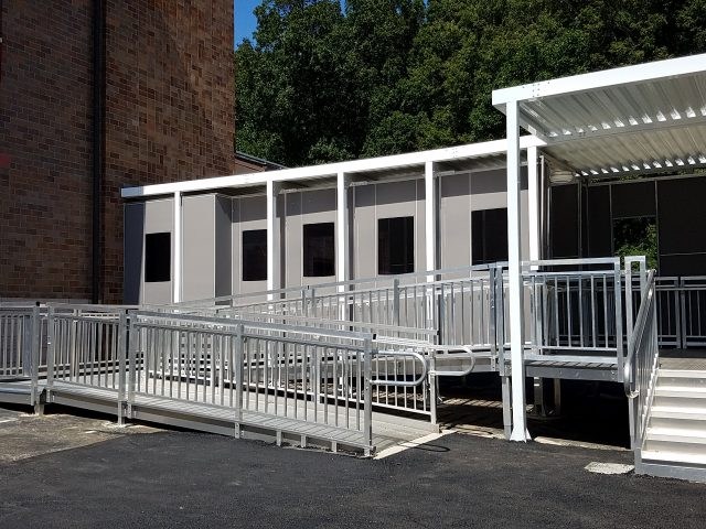 Modular classroom walkway enclosure panels