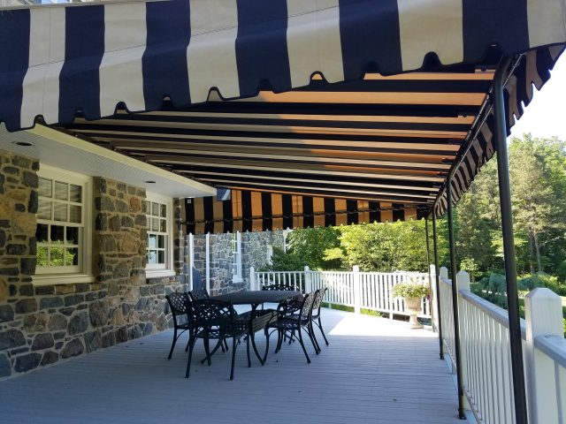 Fixed awning canopy over a deck