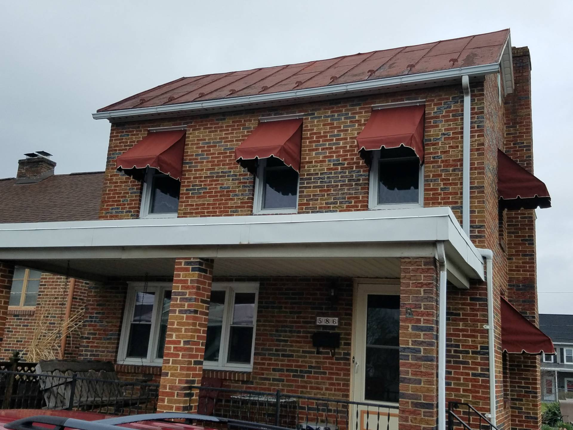 Window Awnings Installed On A Brick Home Kreider S