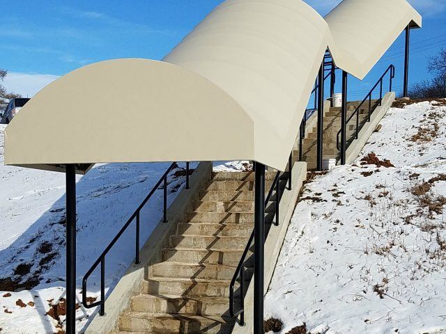 Walkway canopy awning installed over stairs at a retirement community