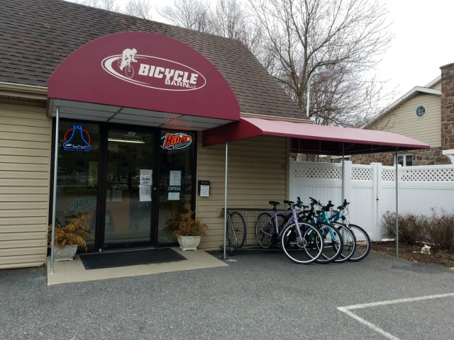 Commercial entrance awning with corporate logo