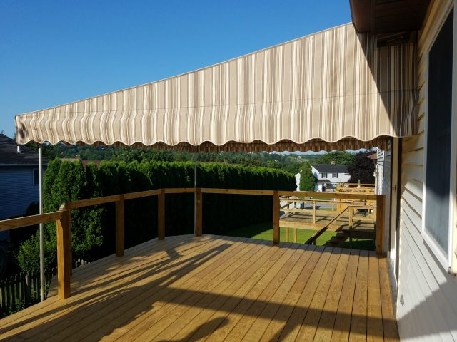 Stationary deck awning with roll down drop curtain shade