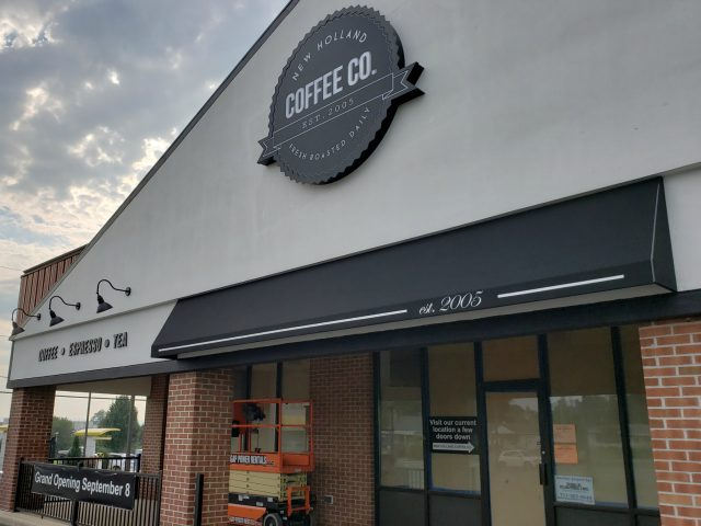 New Holland Coffee Company awnings at drive thru and back door