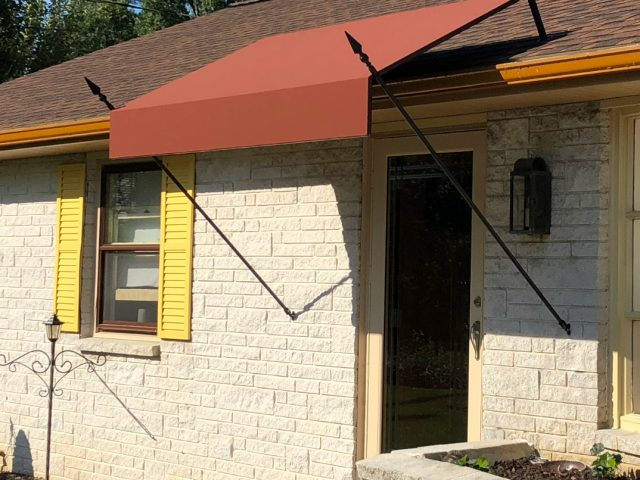 southern style fixed fabric awning with spears
