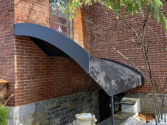 Entrance canopy for a basement stairwell in a church
