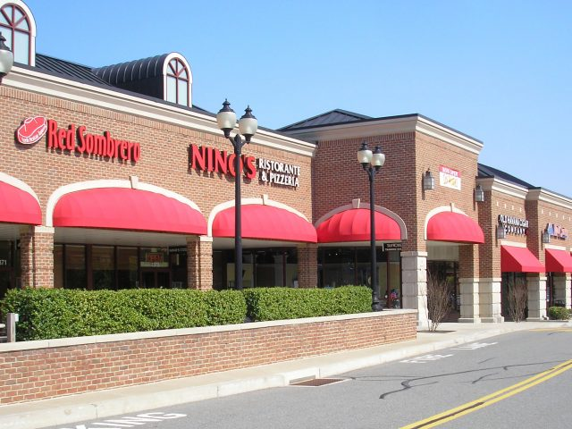 Commercial facade awnings - Red Sunbrella fabric