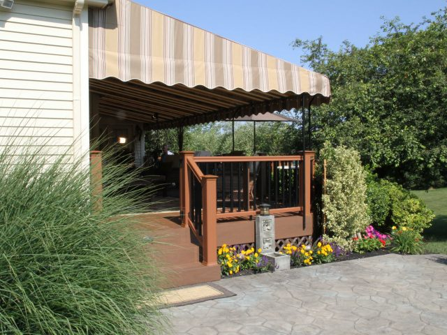 fixed fabric awning over a deck adds functionality to your outdoor living space