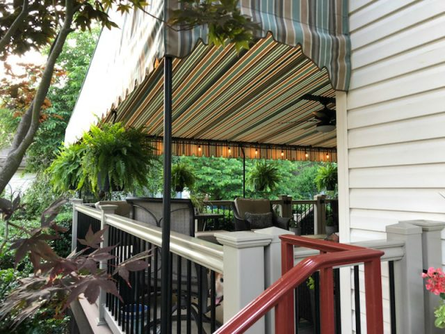 stationary canopy frame deck patio area awning fabric sunbrella striped solid shade rain protection