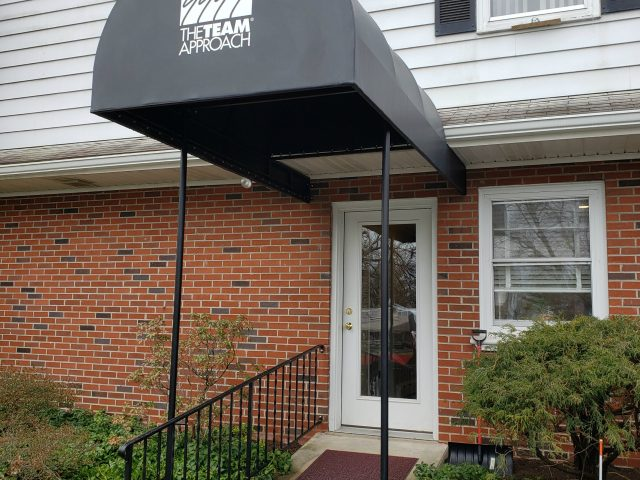 radius arched fabric entrance canopy with lettering graphic sign