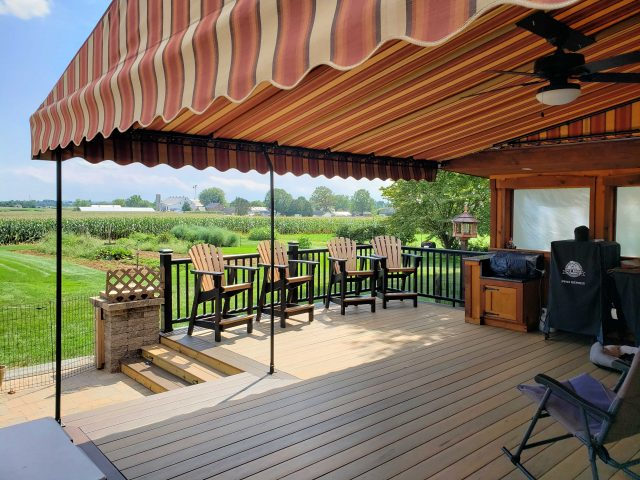 Beautiful canopy custom fit and installed over a deck area outdoor kitchen grill