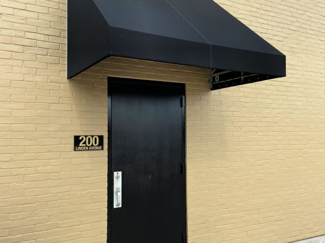 Entrance door awning cover Sunbrella fabric canvas shade commercial office