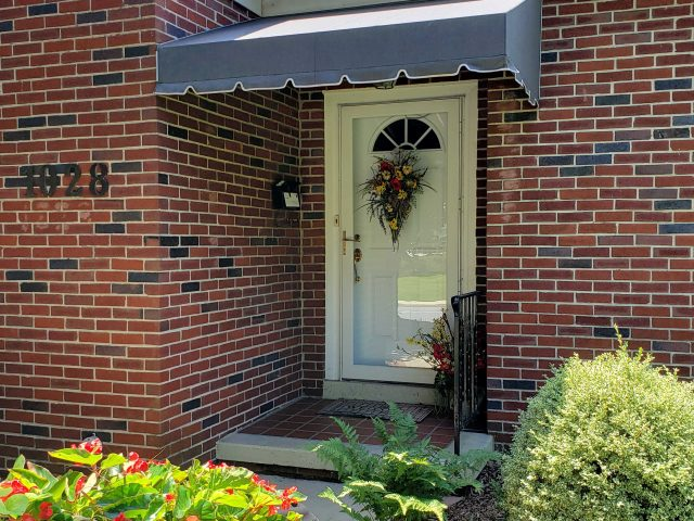 Entrance door awning cover Sunbrella fabric canvas shade