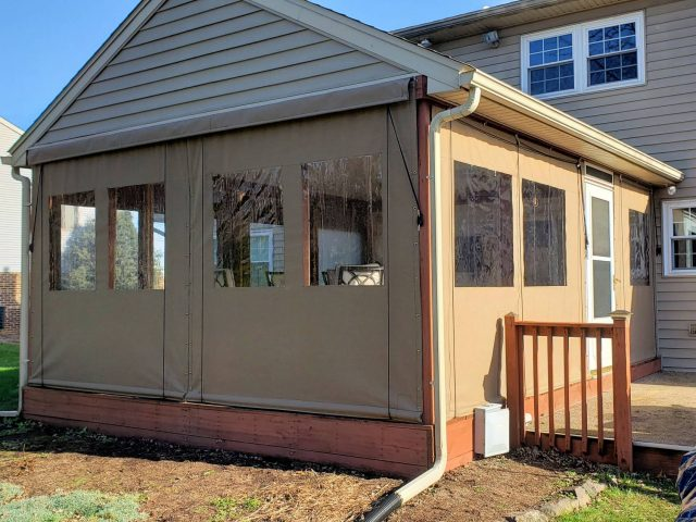 sunbrella drop curtains with clear vinyl windows installed around a porch in Ephrata PA Lancaster county