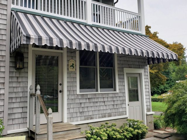 Porch awning cozy privacy traditional scallops valance stipes fabric Sunbrella shade rain protection