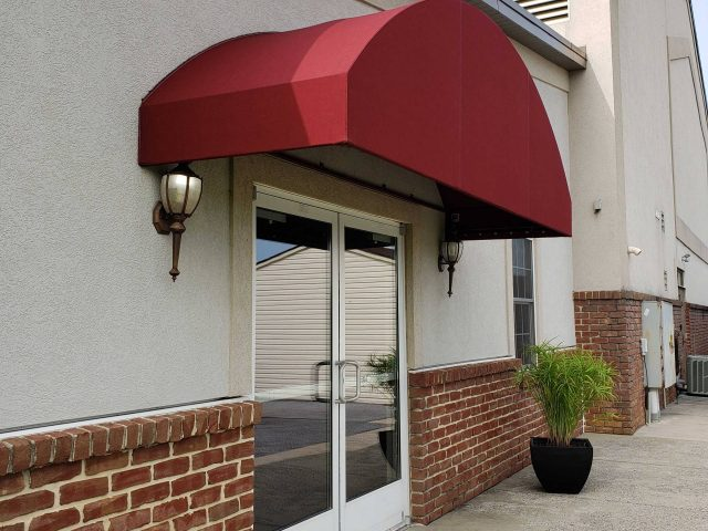 arched top radius rounded door hood entrance awning canopy on a church commercial building facade new holland lancaster pa