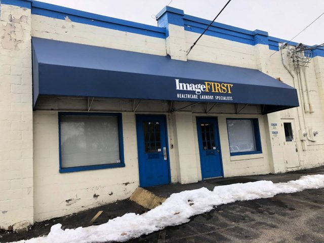 Image First Lancaster shed style traditional commercial awning with lettering vanguard vinyl fabric