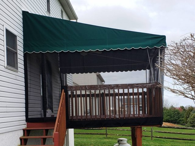 Deck Canopy with Screens drop curtains and a ceiling fan